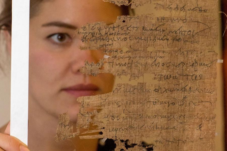 Student studying papyrus