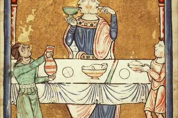 Image of 2 headed man eating and drinking